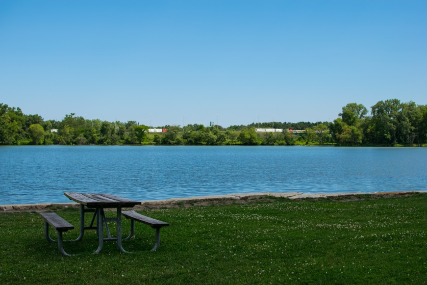 A picnic table sits along a lake in Lansing, Illinois