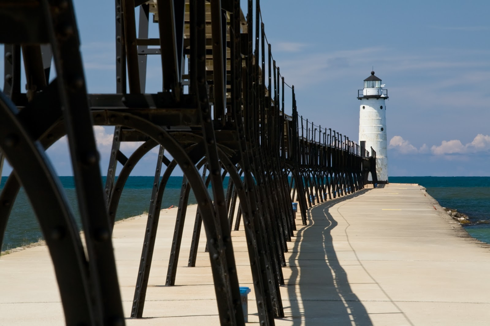 Image of a boardwalk to a lighthouse in Manistee, Michigan