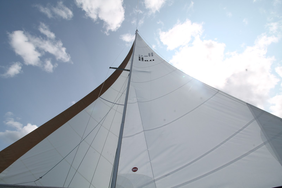 Image of a boat sail on a background of a partially cloudy sky in Michigan City, Indiana